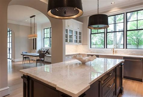 White KItchen with Black Center Island and Black Pendants