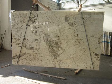 white granite with brown veins and spots kitchen