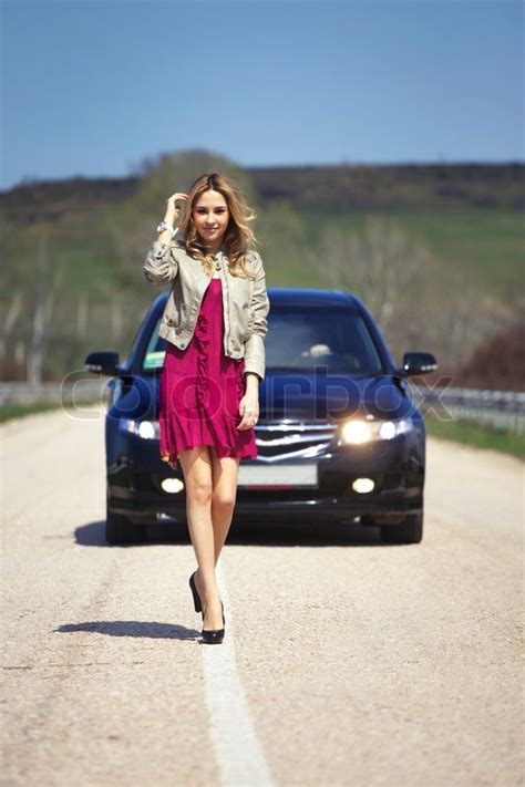 young beautiful girl    road   car