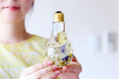 flowers in light bulbs flower light bulb vase suspends beautiful blooms like