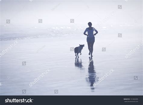 silhouette young woman running  dog stock photo
