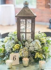 Flower Surrounding Lantern Centerpieces And Table Decor