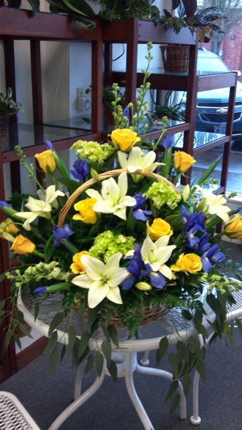 basket arrangement  green hydrangeas yellow roses