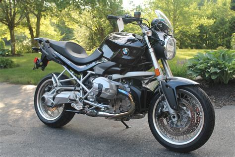 A Bmw Motorcycle Is Stored In My Garage