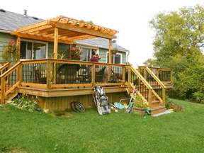 Building Pergola Over Deck by Decks Sheds And More Cedar Deck With Pergola