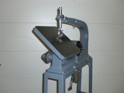 delta scroll   flared leg stand