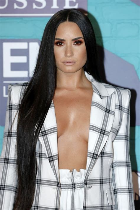 demi lovato sports   cleavage  sexy mtv emas outfit pics entertainment tonight