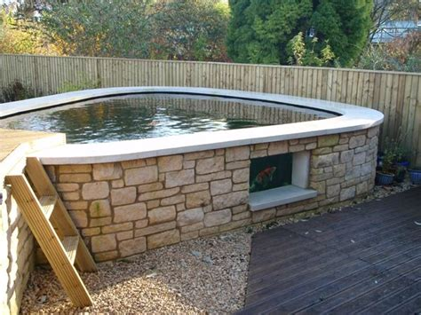 above ground fish ponds building an above ground pond the advanced filtration system is housed under the raised decked