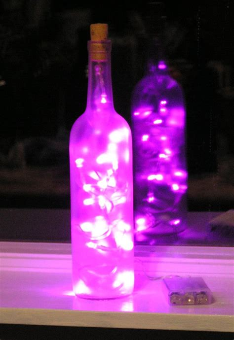 frosted clear wine bottle light with pink led lights