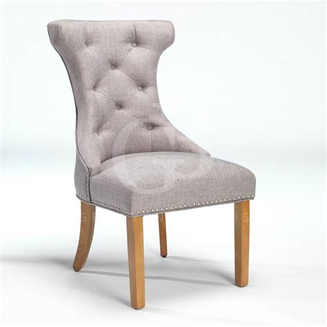 new upholstered wing back dining chair with nickel studs