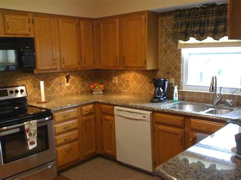 honey cabinets kitchen granite countertops and tile backsplash ideas eclectic 1691