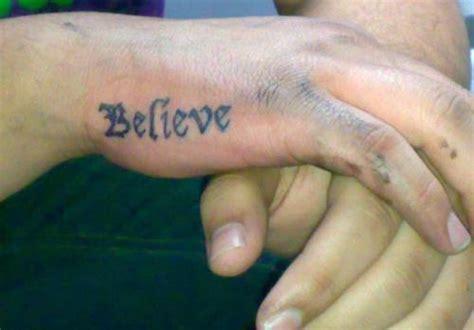 cool tribal design  side hand tattoo