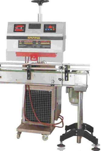 induction cap sealing machine induction sealing machine spheretech packing india pvtltd