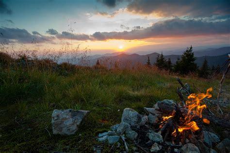 landscape fireplace sun sunset grass stones clouds