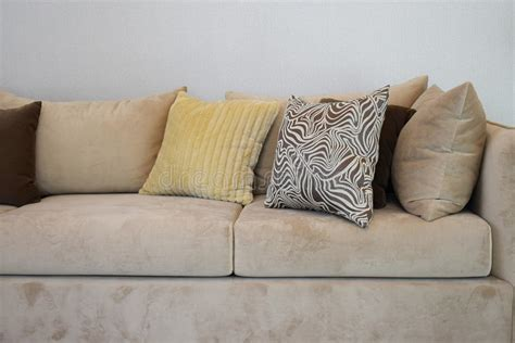Sturdy Brown Tweed Sofa With Grey Patterned Pillows Stock