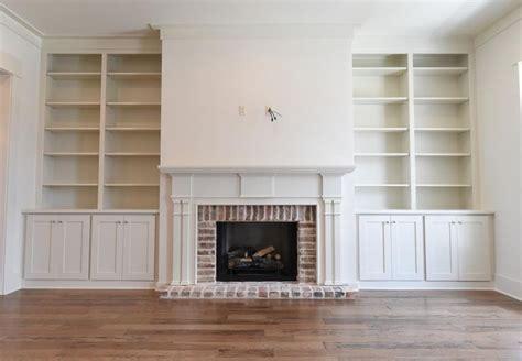 custom  cypress mantle  built  bookcases built