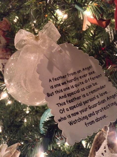 christmas in heaven craft guardian ornament clear ornament filled with some glitter and a single white feather in