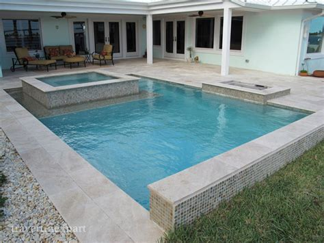 Ivory Tumbled Travertine Pool Deck Tiles, Pavers, and Pool