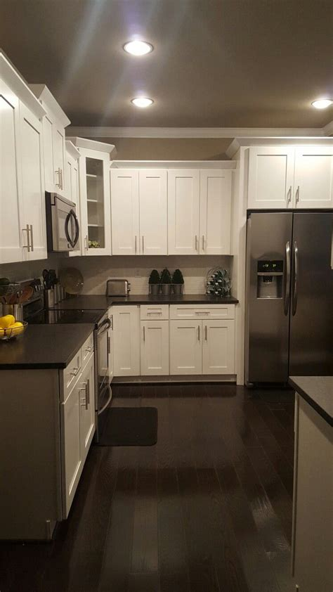white shaker cabinets  black pearl leathered granite
