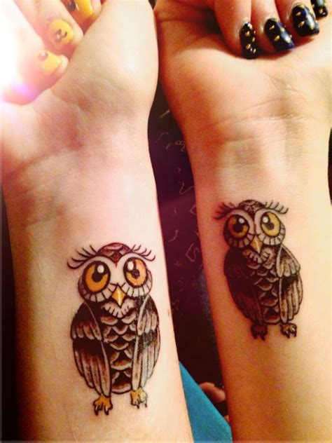 attractive owl wrist tattoos design