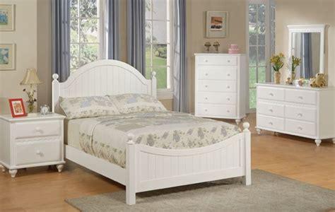 cottage style white finish wood panel bedroom