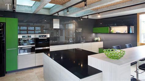 award winning poggenpohl kitchen  black backsplash