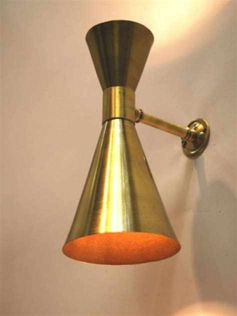double up and down wall light finished in soft brass