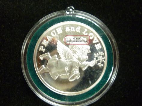 2006 silver round peace love christmas ornament one troy