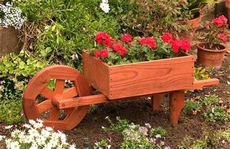 How To Build A Boat Planter by 10 Diy Wooden Wheelbarrow Planter Diy To Make