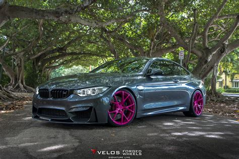 bmw   pink wheels poses  breast cancer awareness