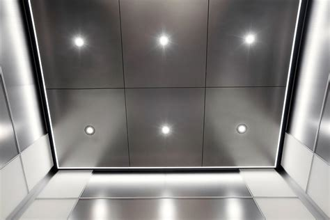 elevator ceiling in stainless steel with seastone finish