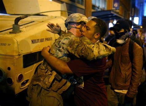Man hugs police in riot gear at Charlotte protests