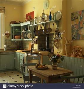 Old Pine Table And Chairs In Old Fashioned Yellow Kitchen