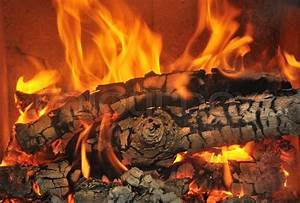 Burning wood in the fireplace and the flames   Stock Photo ...