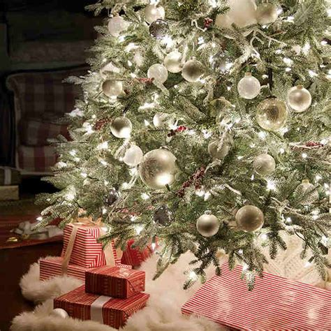 snowy white themed tree christmas tree decorating ideas