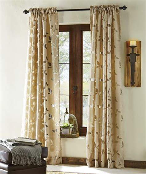window treatment ideas to make a room look bigger