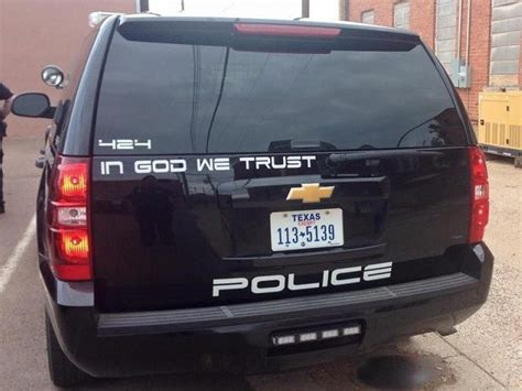 fight texas cops displaying  god  trust  cars