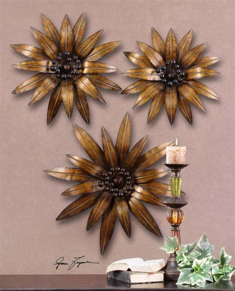 Zinc and gold metal etched disc wall art set of 3. Uttermost Antiqued Gold Gazanias Set Of 3 Flower Metal Wall Art Antiqued Gold Leaf With ...