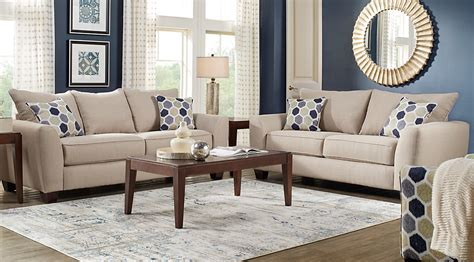 This red, beige and white living room is achieved by using a favorite fabric to make curtains, pillows and an ottoman cover. Beige, Brown & Blue Living Room Furniture & Decorating Ideas
