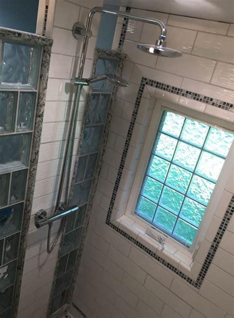 small shower remodeling   open curved glass block shower wall  tile blocks