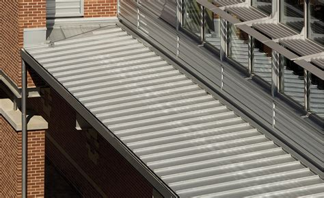 case study pac clad metal panels redefine marist schools appearance    roofing