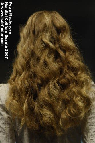 Back view of long mid-back hair with large waves