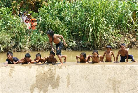asian children bath   river editorial stock photo