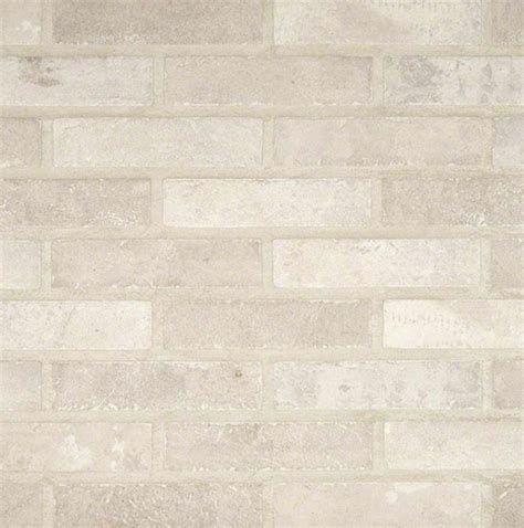 ivory brick 2 1 3 in x 10 in glazed porcelain floor and