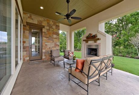 white stucco fireplace contrasts  stone accents