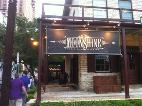 Moonshine Patio Bar Grill Happy Hour by They Did A Of Putting This Roof Around The Tree