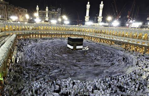 long exposure   muslim pilgrims circling  kaaba