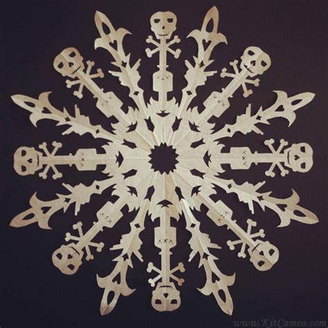 intricate paper snowflakes inspired  star wars