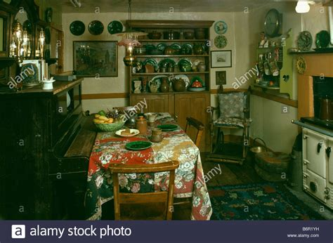Piano And Table With Floral Cloth In Dark Oldfashioned. Kichen Paint. White Kitchen Light Grey Walls. Kitchen Tile Around Window. Vintage Kitchen Lamp