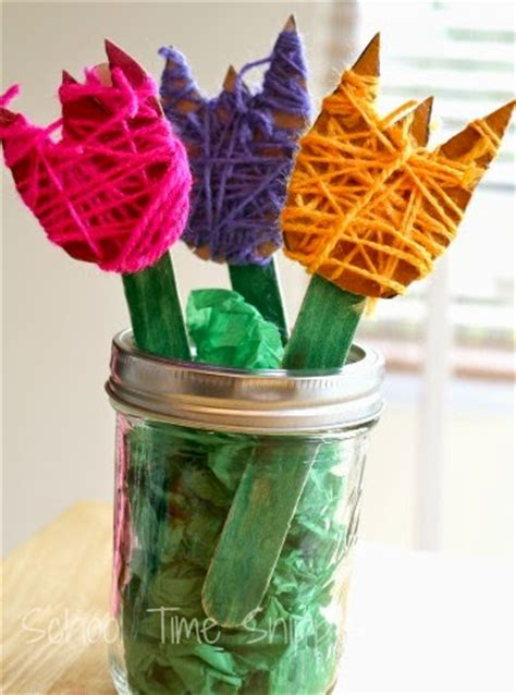 the loveliest activities for preschoolers how 854 | Spring activities for preschoolers yarn wrapped flowers